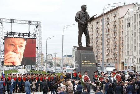 People gather for the opening ceremony of a monument to Mikhail Kalashnikov, the Russian designer of the AK-47 assault rifle, in Moscow, Russia September 19, 2017. REUTERS/Sergei Karpukhin