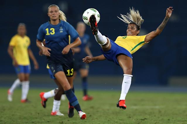 <p>Fabiana of Brazil jumps for the ball while Fridolina Rolfo of Sweden looks on during the Women's Group E first round match between Brazil and Sweden on Day 1 of the Rio 2016 Olympic Games at the Olympic Stadium on August 6, 2016 in Rio de Janeiro, Brazil. (Photo by Buda Mendes/Getty Images) </p>