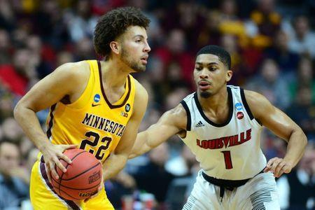 Mar 21, 2019; Des Moines, IA, United States; Minnesota Golden Gophers guard Gabe Kalscheur (22) and Louisville Cardinals guard Christen Cunningham (1) during the second half in the first round of the 2019 NCAA Tournament at Wells Fargo Arena. Mandatory Credit: Jeffrey Becker-USA TODAY Sports