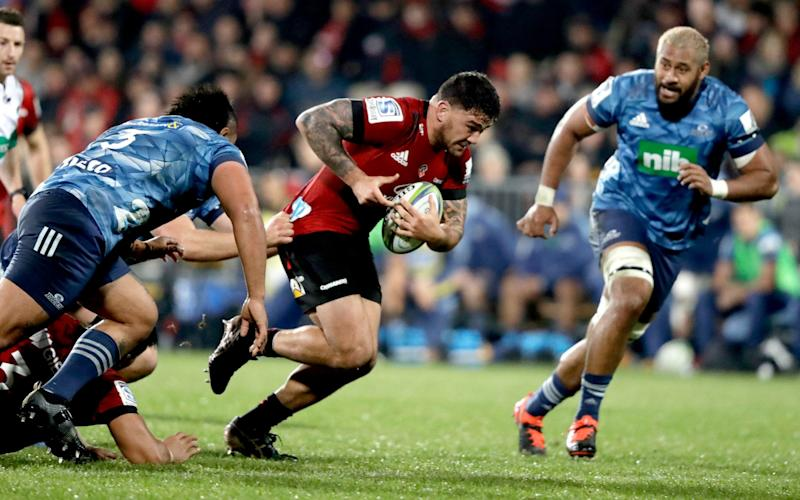 Crusaders Codie Taylor runs at the defence during the Super Rugby Aotearoa rugby game between the Crusaders and the Blues in Christchurch, - AP Photo/Mark Baker