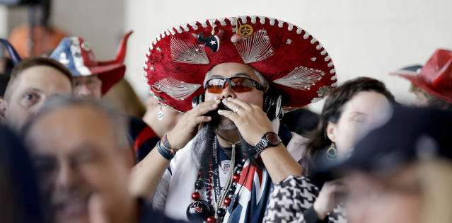 Houston Texans fan Frank Carrera adjusts his mustache as he waits for the start of the NFL draft at a Houston Texans draft day party at NRG Stadium Thursday, May 8, 2014, in Houston. The Texans have the number one pick in the NFL draft. (AP Photo/David J. Phillip)