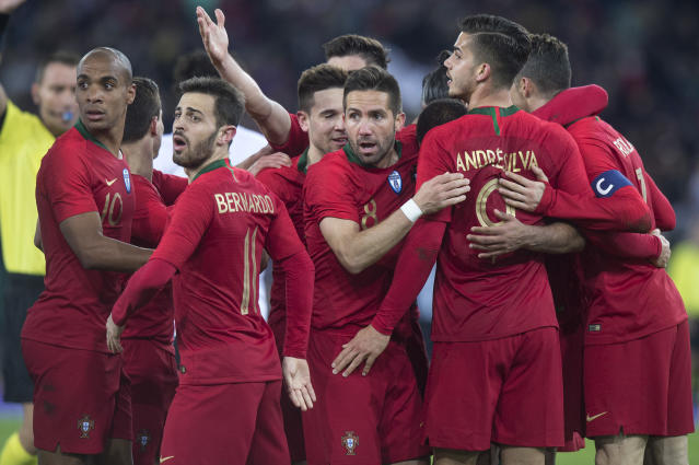 Portugal's Joao Mario, left, Bernardo Silva, Joao Moutinho, middle, celebrate during their soccer friendly game Portugal against Egypt, in the Letzigrund stadium in Zurich, Switzerland, on Friday, March 23, 2018. (Melanie Duchene/Keystone via AP)