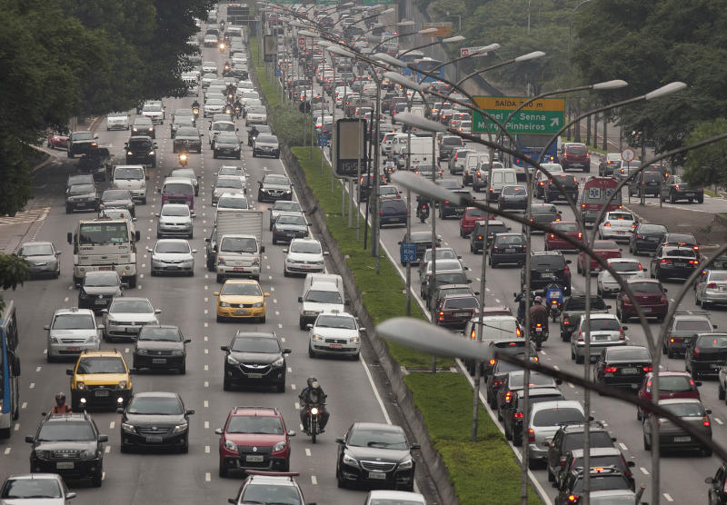 Vehicles drive on a highway in Sao Paulo, Brazil on June 1, 2012. Experts and engineers inside the automotive industry say cars in Brazil are produced with weaker welds, scant safety features and inferior materials compared to similar models manufactured for U.S. and European consumers. Four of Brazil's five bestselling cars failed their independent crash tests. (AP Photo/Andre Penner)
