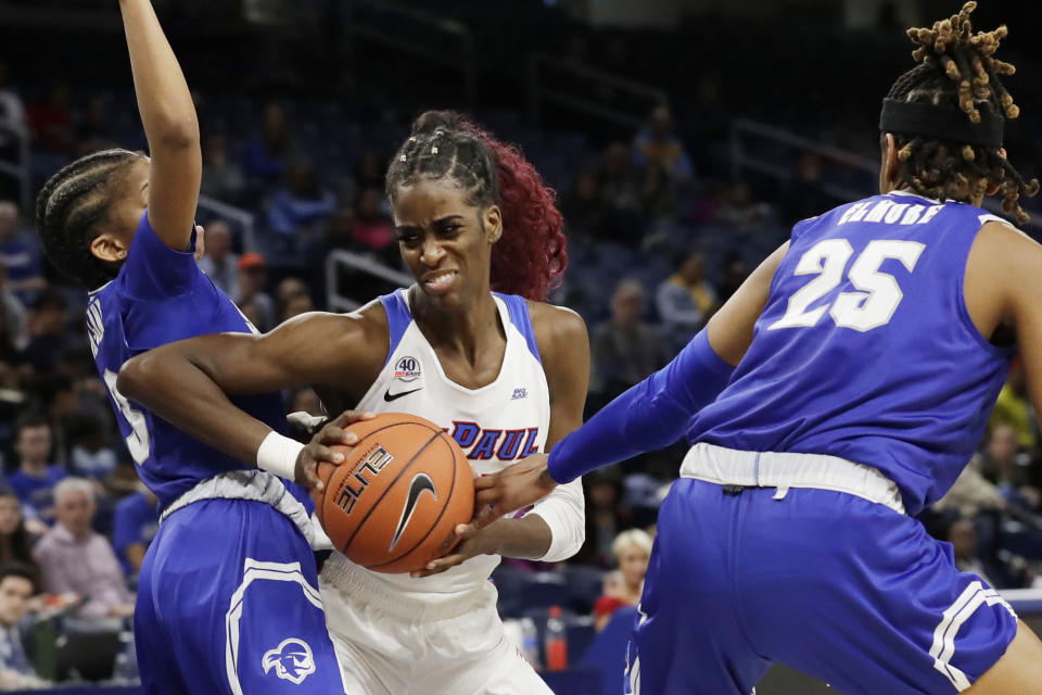 DePaul forward Chante Stonewall, center, drives to the basket against Seton Hall guard Lauren Park-Lane, left, and guard/forward Desiree Elmore during the first half of an NCAA college basketball game in the Big East women's tournament semifinals, Sunday, March 8, 2020, in Chicago. (AP Photo/Nam Y. Huh)