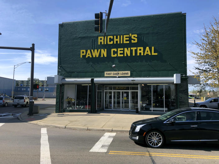 """This April 9, 2021, file photo shows Ritchies Pawn Central, a store in Middleton, Ohio mentioned in J.D. Vance's book """"Hillbilly Elegy"""". Vance, whose book helped explain to the nation Donald Trump's popularity among the Appalachian working class, is """"thinking seriously"""" about running for the U.S. Senate seat Republican two-term incumbent Rob Portman decided against seeking again in 2022. (AP Photo/Dan Sewell)"""