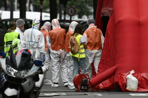 Forensic police worked at the scene of the in shooting in Liege, Belgium, where a gunman shot dead two policewomen with their own weapons before killing a bystander