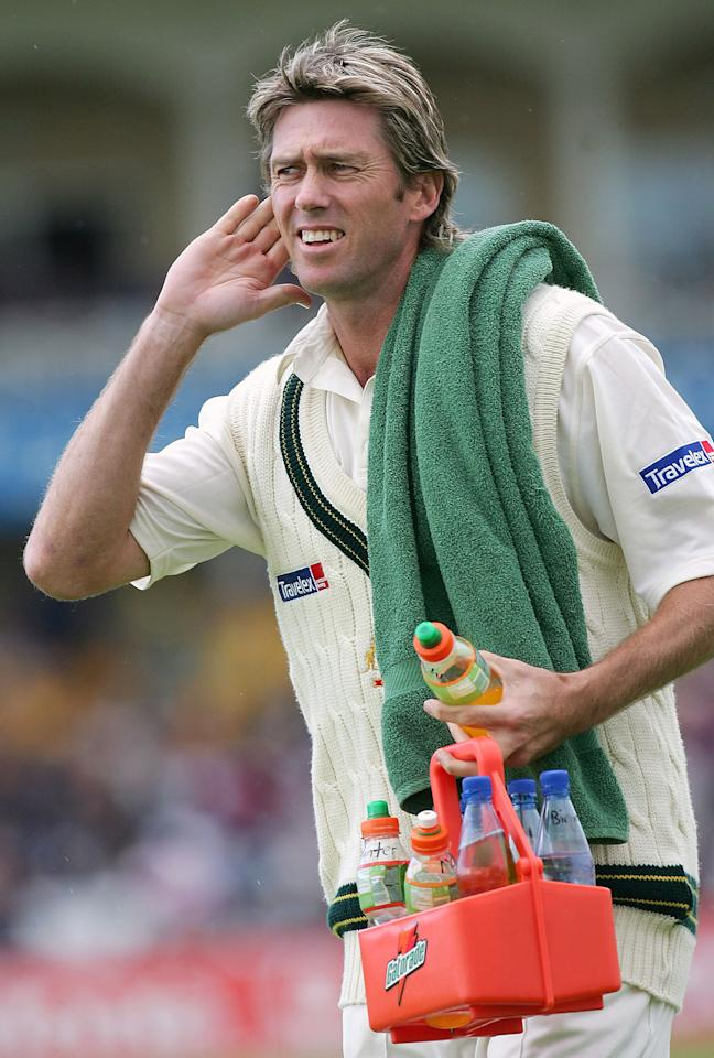 NOTTINGHAM, UNITED KINGDOM - AUGUST 25:  Glenn McGrath of Australia who missed the Test through injury carries the drinks during day one of the Fourth npower Ashes Test between England and Australia played at Trent Bridge on August 25, 2005 in Nottingham, United Kingdom  (Photo by Hamish Blair/Getty Images)