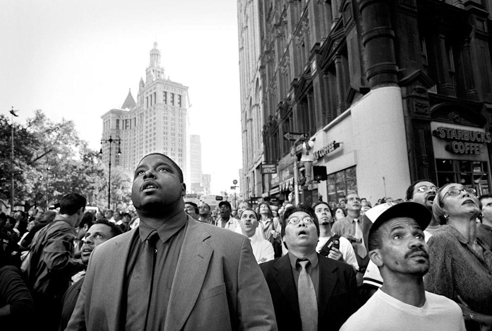 <p>A crowd of stunned New Yorkers watch the collapse of the south tower of the World Trade Center at 9:59am, September 11, 2001. </p>