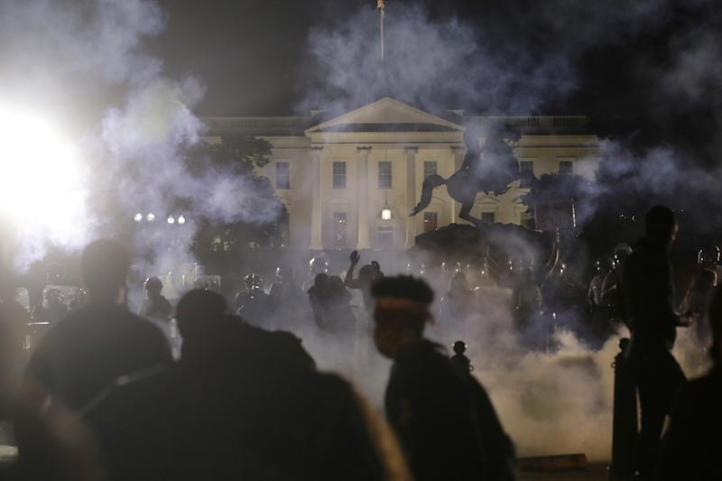 Protesters rally at the White House as America unravels in violent protests. Source: Reuters