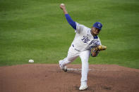 Kansas City Royals starting pitcher Ronald Bolaos throws during the second inning of the team's baseball game against the Chicago White Sox on Saturday, Aug. 1, 2020, in Kansas City, Mo. (AP Photo/Charlie Riedel)