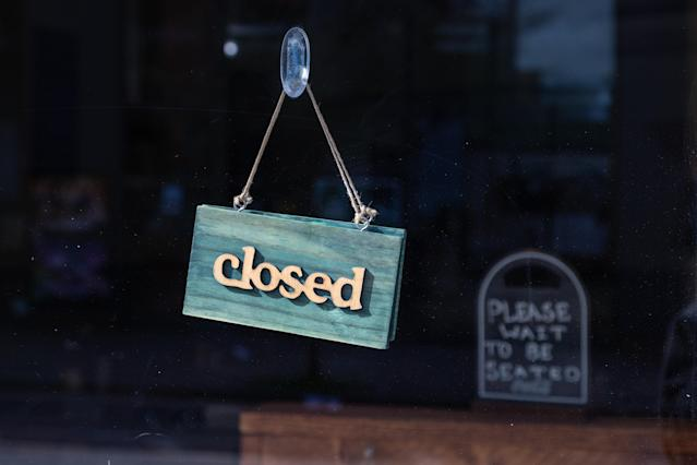 A closed sign hangs at the entrance of a restaurant during lockdown in London. (Getty)