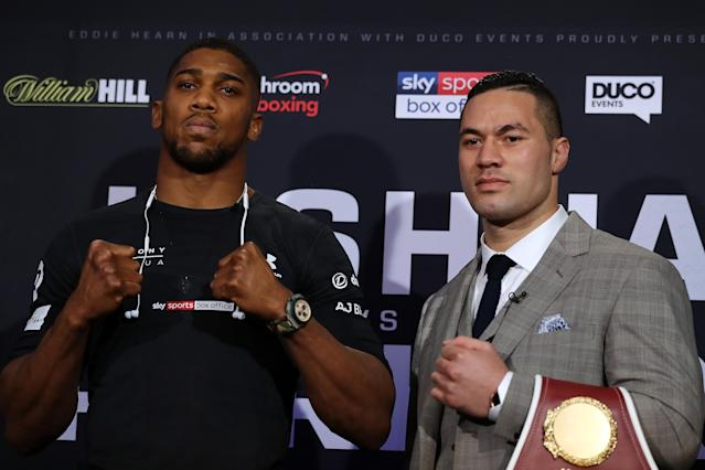 IBF-WBA heavyweight champion Anthony Joshua (20-0, 20 KOs) poses with WBO champion Joseph Parker (24-0, 18 KOs) ahead of their title unification bout Saturday in Cardiff, Wales. (Getty Images)