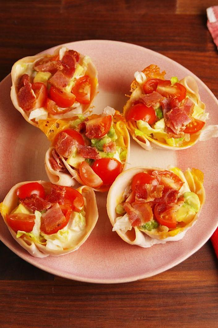 """<p>The classic sandwich becomes an even easier-to-eat finger food.</p><p>Get the recipe from <a href=""""https://delish.com/cooking/recipe-ideas/recipes/a53022/turkey-club-cups-recipe/"""" rel=""""nofollow noopener"""" target=""""_blank"""" data-ylk=""""slk:Delish"""" class=""""link rapid-noclick-resp"""">Delish</a>.</p>"""
