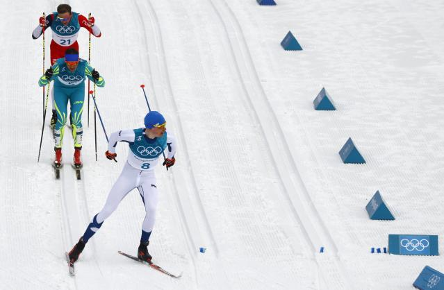Cross-Country Skiing - Pyeongchang 2018 Winter Olympics - Men's 50km Mass Start Classic - Alpensia Cross-Country Skiing Centre - Pyeongchang, South Korea - February 24, 2018 - Iivo Niskanen of Finland leads the competitotrs followed by Alexey Poltoranin of Kazakhstan and Niklas Dyrhaug of Norway. REUTERS/Kai Pfaffenbach
