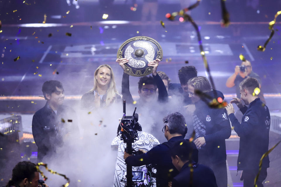 Players of Europe's OG pose for photos with their trophy after winning The International Dota 2 tournament during the TI9 grand final match in Shanghai, China, 25 August 2019. Europe's OG has claimed the world's largest esports prize, worth over USD15.6 million, by winning The International Dota 2 tournament for the second time. OG defeated Netherlands-based Team Liquid 3-1 in the finals in Shanghai Sunday (25 August 2019), becoming the only team to win the annual tournament twice, the National Business Daily reported. China's PSG.LGD came in third in the competition that was organized in China for the first time. (Photo by Ding zhenjie - Imaginechina/Sipa USA)