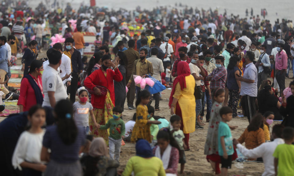 People crowd Juhu beach in Mumbai, India, Friday, Feb. 19, 2021.