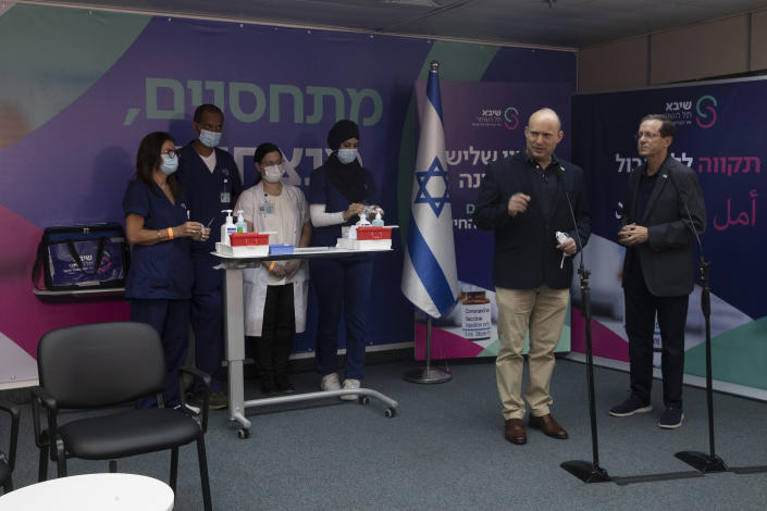 Israeli Prime Minister Naftali Bennett, front left, speaks to journalists with President Isaac Herzog, who received a third coronavirus vaccine at the Sheba Medical Center in Ramat Gan, Israel, Friday, July 30, 2021.(AP Photo/Maya Alleruzzo, Pool)