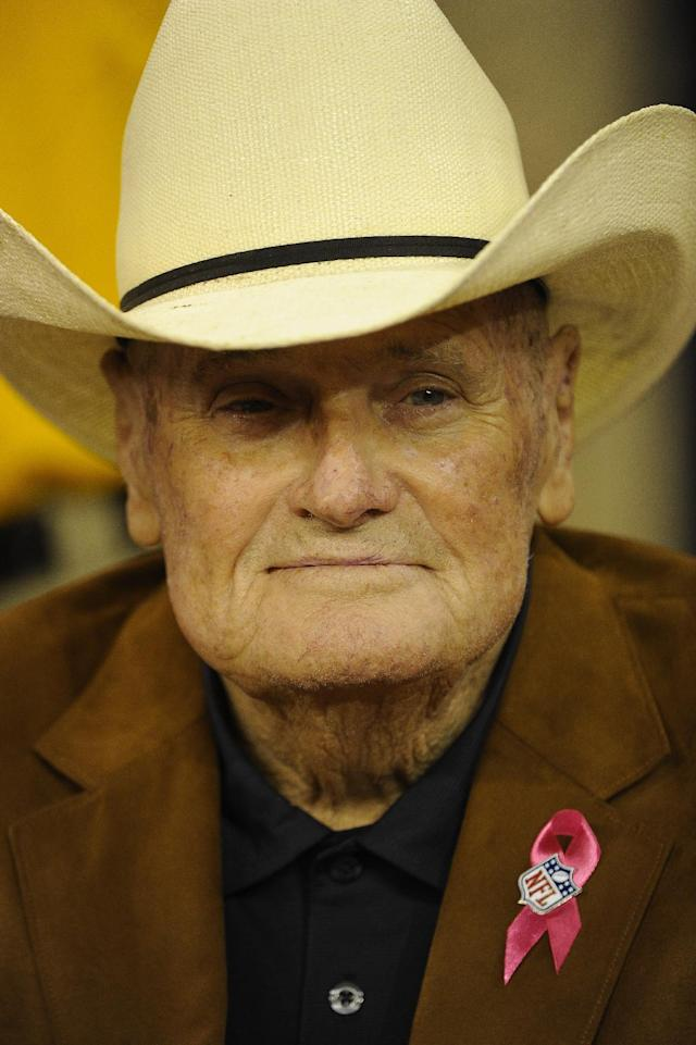 Former Houston Oilers head coach Bum Phillips watches from the bench before an NFL football game between the Green Bay Packers and Houston Texans, Sunday, Oct. 14, 2012 in Houston. (AP Photo/Dave Einsel)