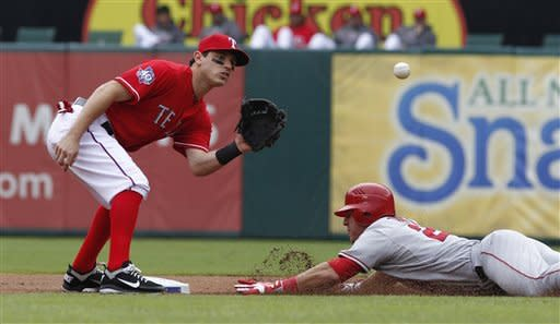Los Angeles Angels Mike Trout (27) steals second base against Texas Rangers Ian Kinsler during the first inning of game one of a baseball double header Sunday, Sept. 30, 2012, in Arlington, Texas. (AP Photo/LM Otero)