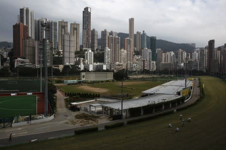 Luxurious residential blocks are seen behind Happy Valley horse racing track in Hong Kong