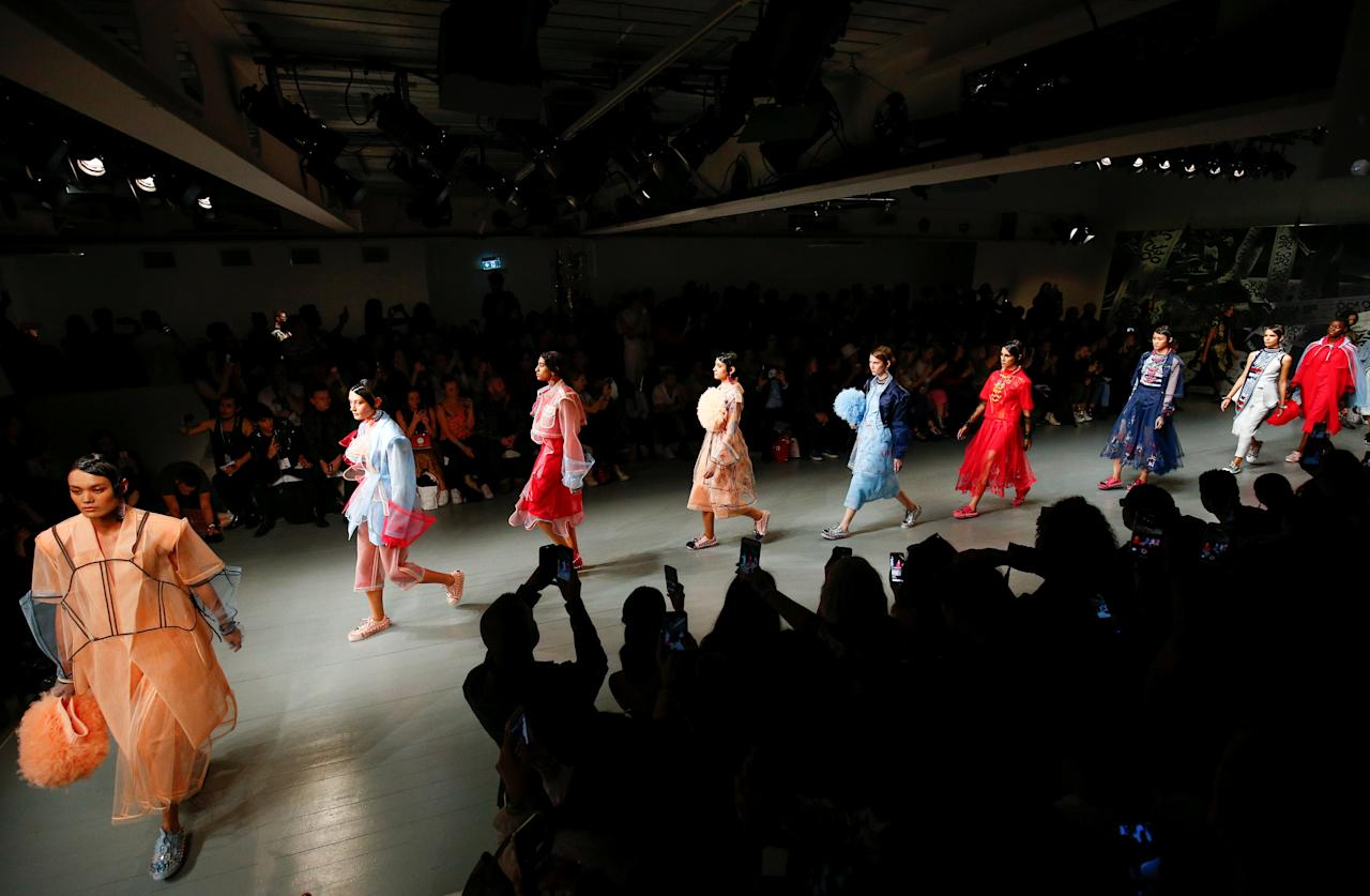 Models present creations at the On|Off catwalk show during London Fashion Week in London, Britain September 18, 2018. REUTERS/Henry Nicholls