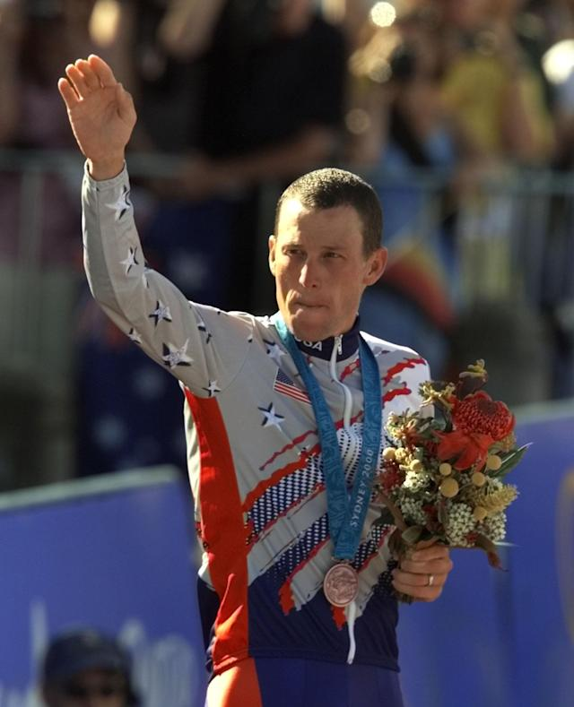 FILE - In a Sept. 30, 2000 file photo, U.S. cyclist Lance Armstrong waves after receiving the bronze medal in the men's individual time trials at the 2000 Summer Olympics cycling road course in Sydney, Australia. The IOC formally opened an investigation Thursday, Nov. 1, 2012, that could result in Lance Armstrong being stripped of his Olympic bronze medal for doping. (AP Photo/Ricardo Mazalan, File)