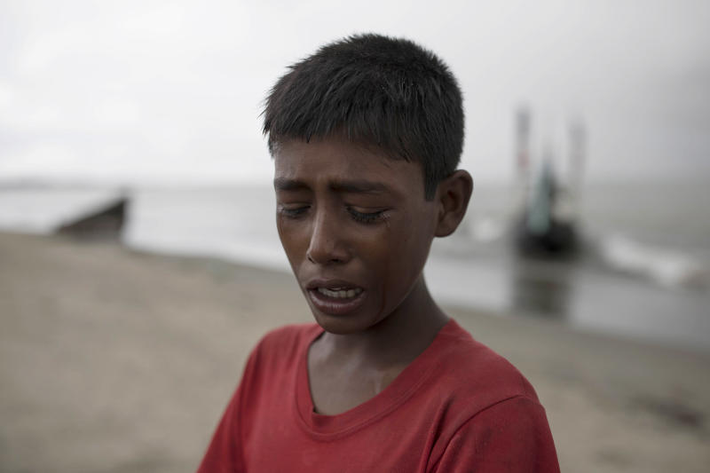 A young Rohinga boy cries after the wooden boat he was traveling on from Myanmar crashed into the shore, Sept. 12, 2017, in Dakhinpara, Bangladesh. (Dan Kitwood via Getty Images)