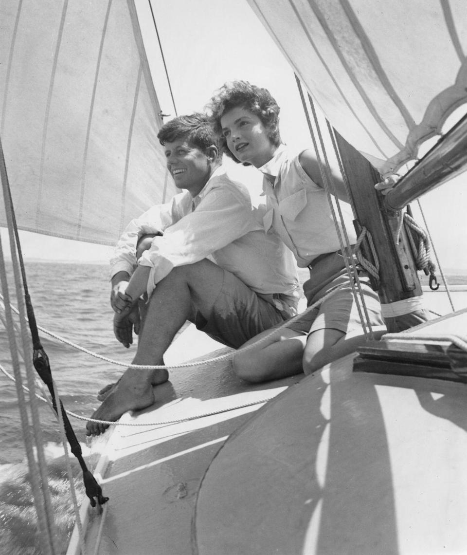 <p>Senator John F. Kennedy and his fiancée Jacqueline Bouvier enjoy sailing while in Hyannis Port, Massachusetts. Jackie wears a button-down sleeveless blouse and tailored shorts. <br></p>