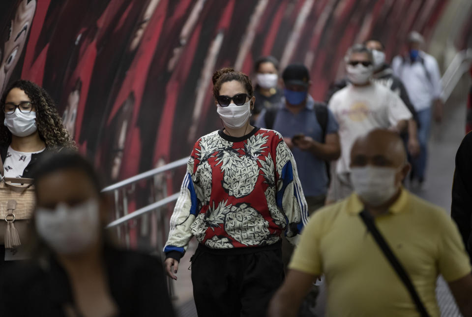 Commuters wear face masks inside the subway system amid the spread of the new coronavirus in Sao Paulo, Brazil, Monday, May 4, 2020. The state government mandated that commuters using public transportation must wear face masks starting Monday. (AP Photo/Andre Penner)