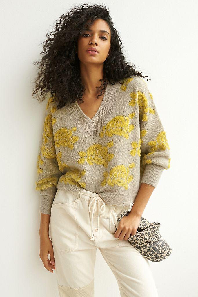 """<h2>Lucila Sweater</h2><br>Impressionistic rosebud shapes and a gently frayed hem adorn this loose-knit regular- and plus-sized sweater, giving it a chic, found vibe.<br><br><strong>Anthropologie</strong> Lucila Sweater, $, available at <a href=""""https://go.skimresources.com/?id=30283X879131&url=https%3A%2F%2Fwww.anthropologie.com%2Fshop%2Flucila-sweater2%3Fcategory%3Dtops-sweaters%26color%3D035%26type%3DPLUS%26quantity%3D1"""" rel=""""nofollow noopener"""" target=""""_blank"""" data-ylk=""""slk:Anthropologie"""" class=""""link rapid-noclick-resp"""">Anthropologie</a>"""