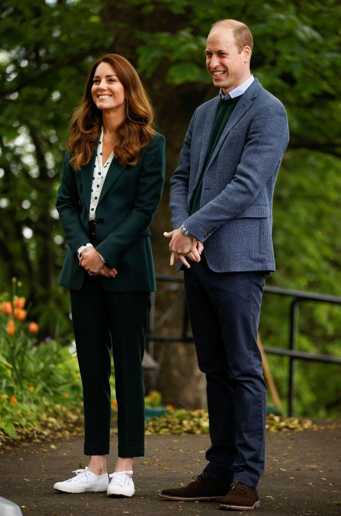 """<p>Kate proved that sometimes it is indeed easy being green, as she began her day in Scotland in a forest green suit. She paired the look with white Superga sneakers. </p><p><a class=""""link rapid-noclick-resp"""" href=""""https://go.redirectingat.com?id=74968X1596630&url=https%3A%2F%2Fwww.shopbop.com%2Fcotu-classic-laceup-sneaker-superga%2Fvp%2Fv%3D1%2F1557486150.htm&sref=https%3A%2F%2Fwww.townandcountrymag.com%2Fstyle%2Ffashion-trends%2Fnews%2Fg1633%2Fkate-middleton-fashion%2F"""" rel=""""nofollow noopener"""" target=""""_blank"""" data-ylk=""""slk:Shop the Sneakers"""">Shop the Sneakers</a></p>"""