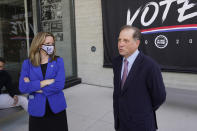 FILE - In this Sept. 24, 2020, file photo, Michigan Secretary of State Jocelyn Benson and Detroit Pistons Vice Chairman Arn Tellem talk about voting and the upcoming elections in Detroit. NFL, NBA, NHL, Major League Baseball, Major League Soccer and college venues are serving various roles in unprecedented ways, including providing space for people to vote while social distancing on Election Day. The Henry Ford Detroit Pistons Performance Center and Ford Field, where the Lions play, will provide socially distant space for receiving boards to double check ballots after they are counted at precincts in the Motor City. (AP Photo/Paul Sancya, File)