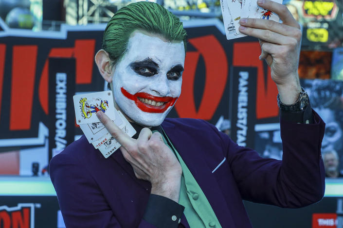 A cosplayer attending New York Comic Con 2019 dressed as the Joker poses for photos at Jacob Javits Center on Saturday in New York City. (Photo: Gordon Donovan/Yahoo News)
