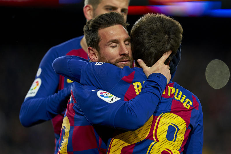 BARCELONA, SPAIN - JANUARY 19: Lionel Messi and Riqui Puig of FC Barcelona celebrating their team's first goal during the Liga match between FC Barcelona and Granada CF at Camp Nou on January 19, 2020 in Barcelona, Spain. (Photo by Quality Sport Images/Getty Images)