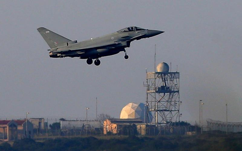 A Typhoon aircraft prepares for landing at the British Royal Air Force base in Akrotiri, near costal city of Limassol in the eastern Mediterranean island of Cyprus, early Saturday - AP