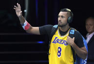 Australia's Nick Kyrgios walks onto Rod Laver Arena wearing a shirt as a tribute to Kobe Bryant ahead of his fourth round singles match against Spain's Rafael Nadal at the Australian Open tennis championship in Melbourne, Australia, Monday, Jan. 27, 2020. (AP Photo/Lee Jin-man)