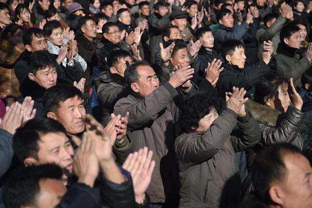 Pyongyang residents react at the Pyongyang Railway Station after the news of the successful launch of the new intercontinental ballistic missile (ICBM) Hwasong-15 in Pyongyang on November 29, 2017. (KIM WON-JIN/AFP/Getty Images)
