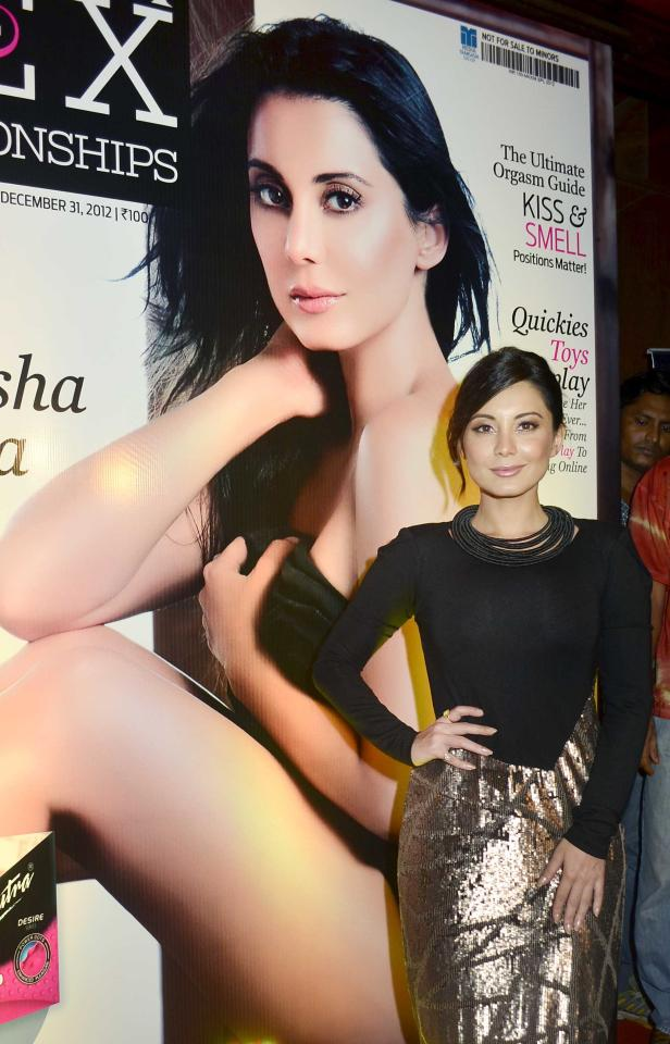 Minissha's glittery dress really doesn't do much for her petite frame. It just makes her look stout. And we're really not big fans of that neck piece.