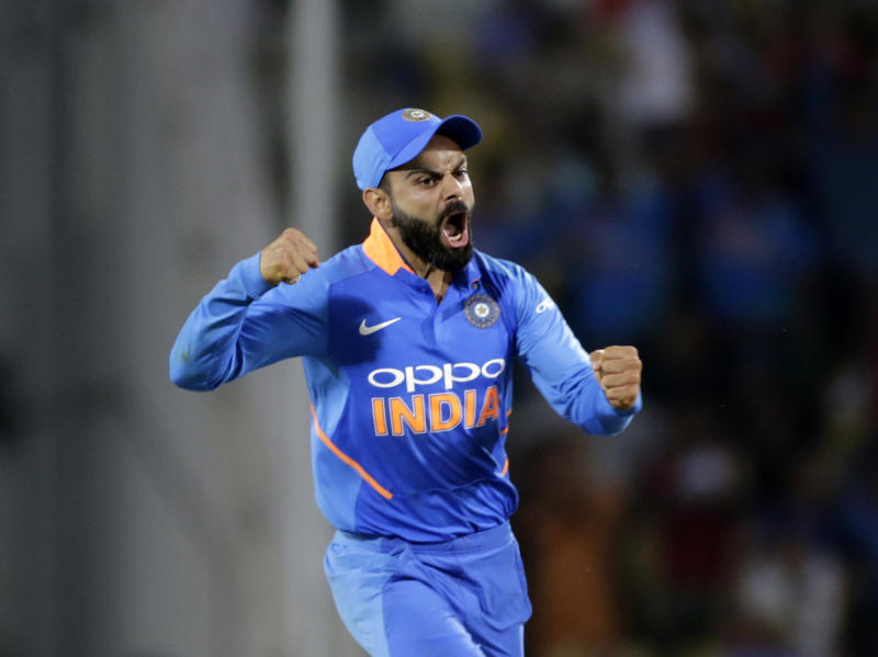 FILE - In this March 5, 2019 file photo, India's Virat Kohli celebrates Australian batsman Peter Handscomb's wicket during the second one-day international cricket match between India and Australia in Nagpur, India. The 2019 Cricket World Cup starts in England on May 31. (AP Photo/Rajanish Kakade, File)