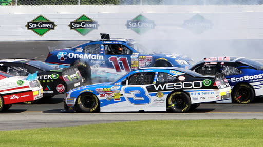 Elliott Sadler (11) spins out during the NASCAR Nationwide Series auto race at New Hampshire Motor Speedway Saturday, July 12, 2014, in Loudon, N.H. (AP Photo/Jim Cole)
