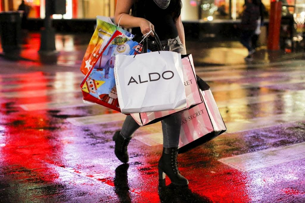 A woman carries shopping bags during Black Friday events on in New York City, Nov. 25, 2016