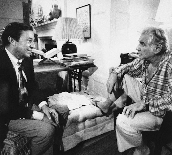 """FILE - In this Feb. 2, 1980 file photo, co-editor Mike Wallace, left, interviews composer Leonard Bernstein during taping of a part of CBS-TV's """"60 Minutes,"""" in New York, in a program set to air four days before a revival of the composer's """"West Side Story"""" that opens on Broadway. Wallace, the dogged, merciless reporter and interviewer who took on politicians, celebrities and other public figures in a 60-year career highlighted by the on-air confrontations that helped make """"60 Minutes"""" the most successful primetime television news program ever, has died. He was 93. (AP Photo, File) NO SALES"""