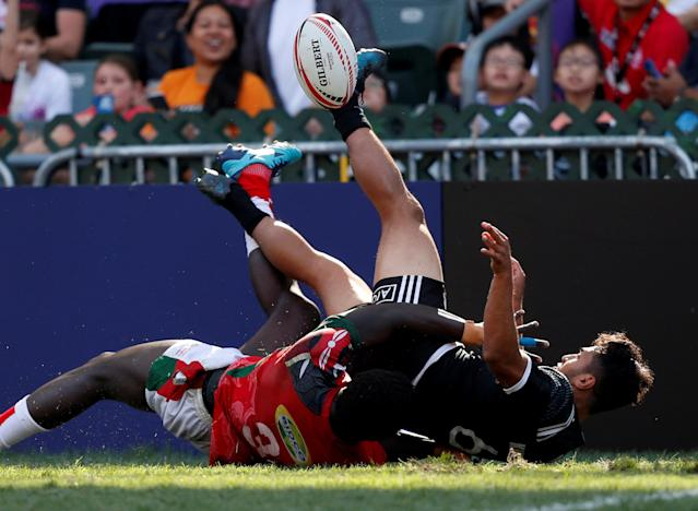 Rugby Union - Kenya v New Zealand - World Rugby Sevens Series - Hong Kong Stadium, Hong Kong, China - April 8, 2018 - New Zealand's Rocky Khan is tackled by Kenya's Oscar Ouma. REUTERS/Bobby Yip