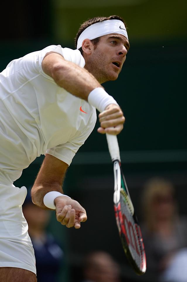 LONDON, ENGLAND - JUNE 27: Juan Martin Del Potro of Argentina serves during his Gentlemen's Singles second round match against Jesse Levine of Canada on day four of the Wimbledon Lawn Tennis Championships at the All England Lawn Tennis and Croquet Club on June 27, 2013 in London, England. (Photo by Dennis Grombkowski/Getty Images)