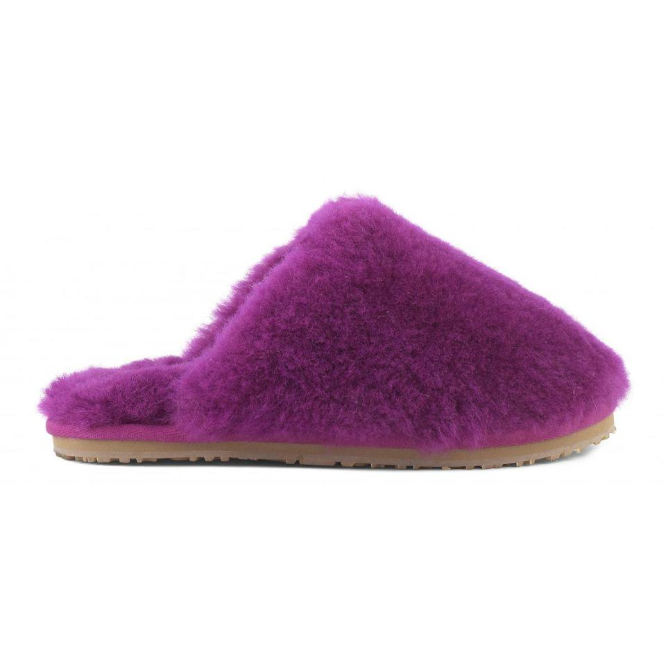 "<p><strong>Mou</strong></p><p>mou-online.com</p><p><strong>445.00</strong></p><p><a href=""https://www.mou-online.com/en-us/shoponline/closed-toe-sheepskin-slipper.mu.fw161000l?color=CYC"" rel=""nofollow noopener"" target=""_blank"" data-ylk=""slk:Shop Now"" class=""link rapid-noclick-resp"">Shop Now</a></p><p>She hasn't worn real shoes in weeks. These fur-lined slides will keep her warm at home.</p>"