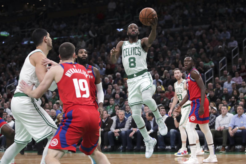 Boston Celtics guard Kemba Walker (8) drives to the basket against the Detroit Pistons during the first half of an NBA basketball game in Boston, Wednesday, Jan. 15, 2020. (AP Photo/Charles Krupa)