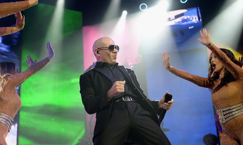 Pitbull, pictured performing on August 1, 2016 in Hollywood, Florida, featured in a Visit Florida video to promote the state's beaches