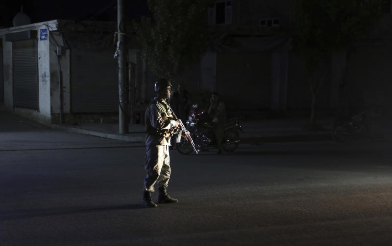 An Afghan police man stand guard outside the wedding hall after an explosion in Kabul, Afghanistan, Sunday, Aug.18, 2019. An explosion ripped through the wedding hall on a busy Saturday night in Afghanistan's capital and dozens of people were killed or wounded, a government official said. Hundreds of people were believed to be inside.(AP Photo/Rafiq Maqbool)