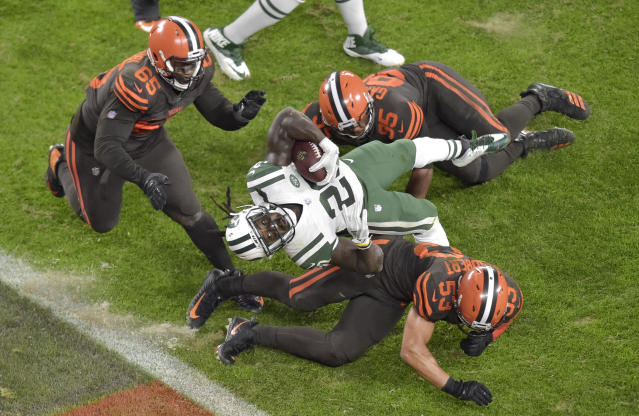 New York Jets running back Isaiah Crowell (20) scores a 2-yard touchdown during the first half of an NFL football game against the Cleveland Browns, Thursday, Sept. 20, 2018, in Cleveland. (AP Photo/David Richard)