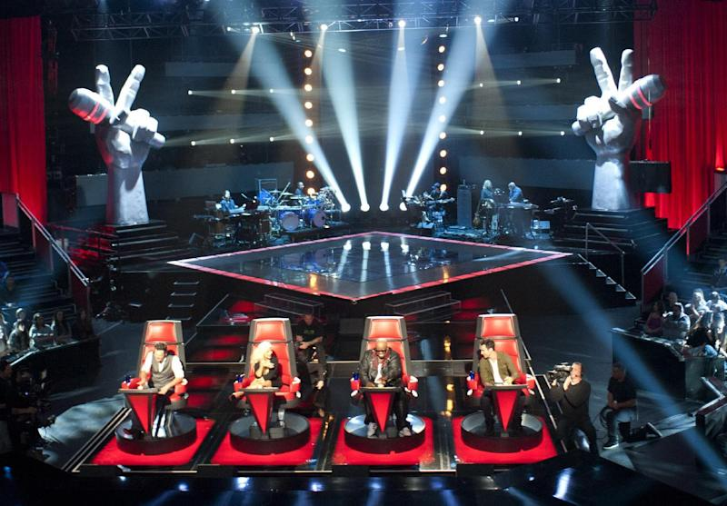"""In this undated image released by NBC, judges, seated from left, Blake Shelton, Christina Aguilera, Cee Lo Green and Adam Levine are shown during a rehearsal for the second season of """"The Voice,"""" in Los Angeles. A new Facebook application will allow fans of NBC's """"The Voice"""" to vote for their favorite artists through their Facebook profiles, now known as their timelines. (AP Photo/NBC, Lewis Jacobs)"""